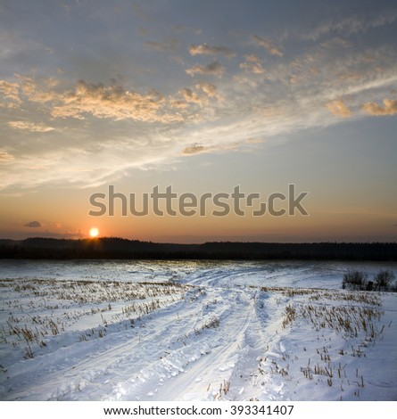 Winter road and sunset - stock photo