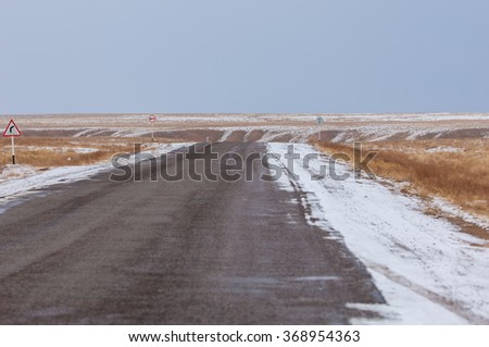 winter road in the desert - stock photo