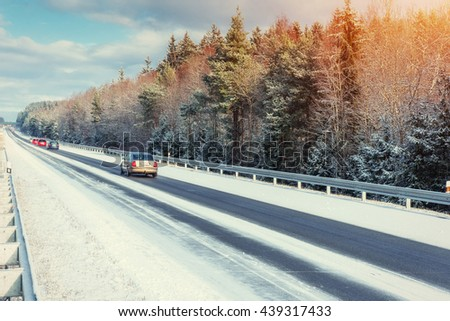 Winter road through snowy fields and forests - stock photo