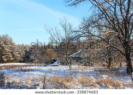 Winter rural landscape with old deserted hut - stock photo