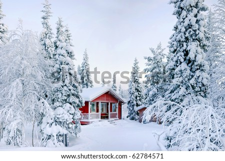 Winter's Tale. Red Finnish cottage in a beautiful snow forest. - stock photo
