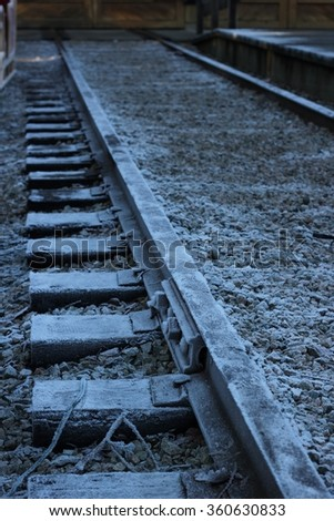 winter scene of frozen train tracks in the countryside - stock photo