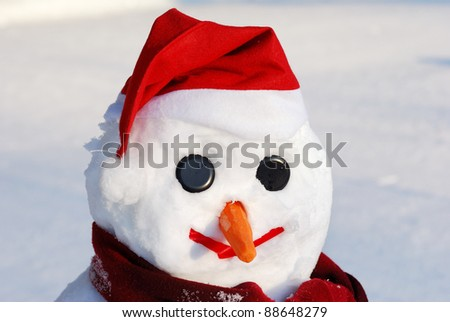 Winter scene with  snowman on  snow background - stock photo
