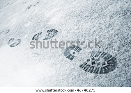 Winter scenic. Trace of boot in the snow. - stock photo