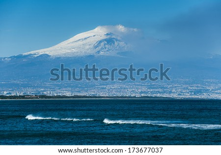 winter sea and Etna Vulcan eruption in the back.  - stock photo