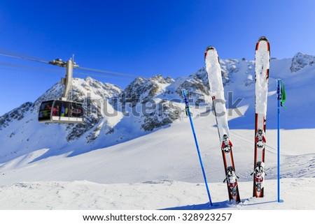 Winter season, ski equipments on ski run - stock photo