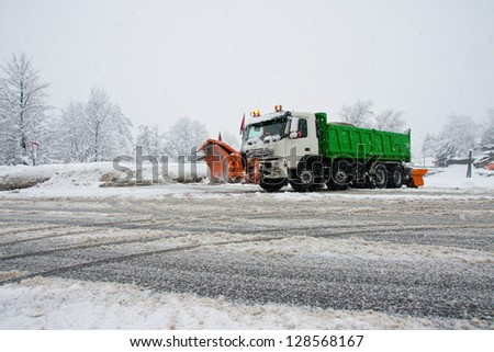 Winter service in action - stock photo