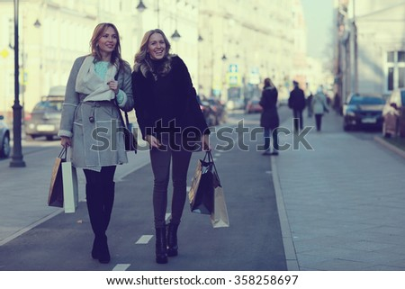winter shopping trip two girlfriends - stock photo