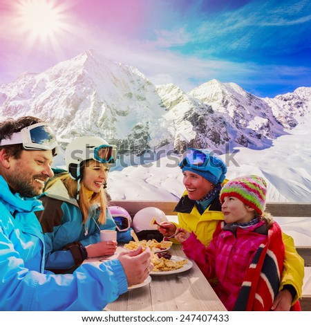 Winter, ski - skiers enjoying break for lunch, filtered - stock photo