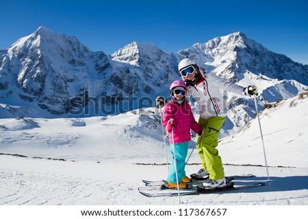 Winter,ski, snow and sun - family enjoying winter vacation - stock photo