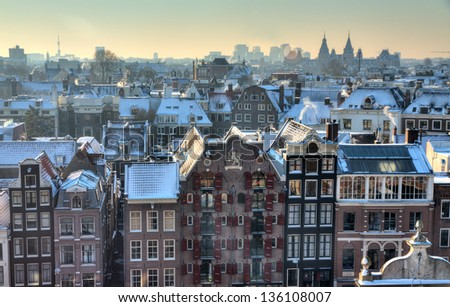 Winter skyline of Amsterdam, the Netherlands, with snow on the rooftops. Looking towards the south with the Rijksmuseum on the horizon - stock photo