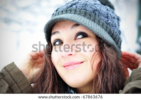 Winter smile. Happy girl in winter set-up, smiling looking upwards - stock photo