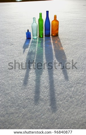 Winter - snow and light-colored bottles games - stock photo
