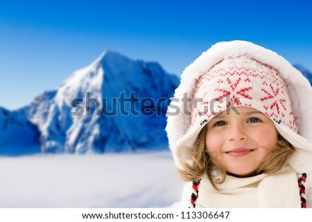 Winter, snow and sun - lovely girl on winter holiday - stock photo