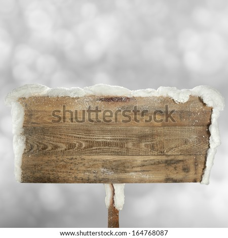 winter snow and wooden sign  - stock photo
