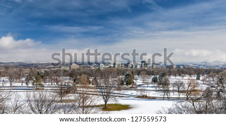 Winter snow covered groups with the city of Boise skyline - stock photo