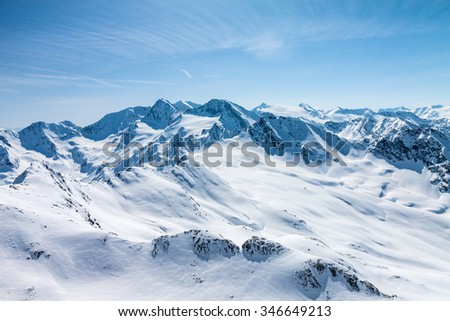 Winter snow covered mountain peaks in Austrian alps  Place for winter sports - stock photo