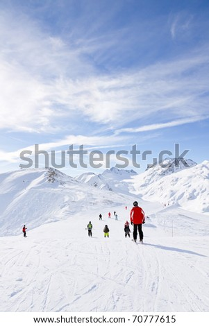 Winter snow mountain landscape with skiing tourists. Alps. France. - stock photo