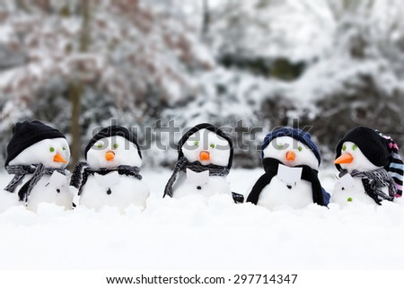 Winter snowman scene with snow and trees - stock photo