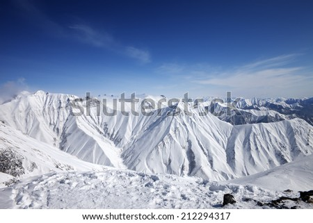 Winter snowy mountains and blue sky. Caucasus Mountains, Georgia, ski resort Gudauri.  - stock photo