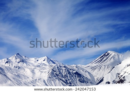 Winter snowy mountains in windy day. Caucasus Mountains, Georgia. Ski resort Gudauri. - stock photo