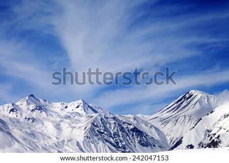 Winter snowy mountains in windy day. Caucasus Mountains, Georgia. Ski resort Gudauri. - stock photo