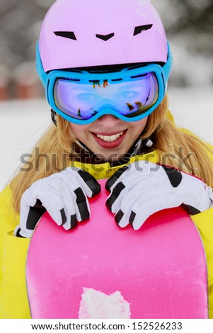 Winter sports - portrait of young snowboarder girl - stock photo