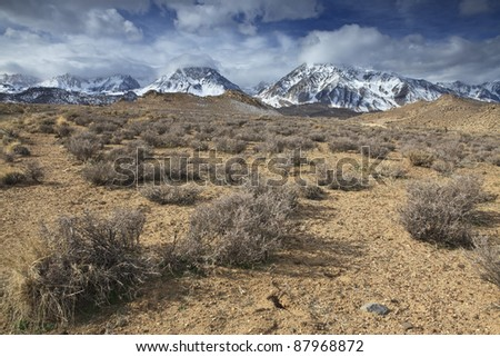 Winter storm clouds over Sierra Nevada mountains in California - stock photo