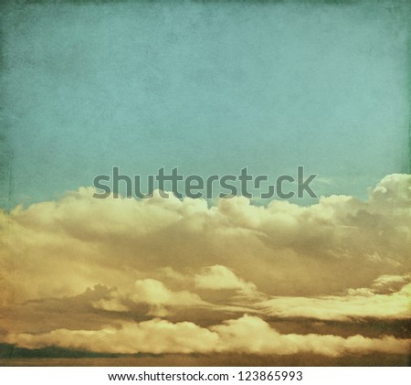 Winter storm clouds rendered with vintage colors.  Image has a pleasing paper grain and texture visible at 100%. - stock photo