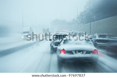 Winter Storm Traffic. I-294 Chicago Highway During Snow Storm. Heavy Snowfall and Heavy Traffic. - stock photo