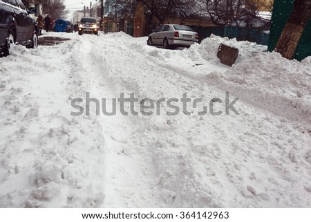 Winter street with lots of snow in Odessa - stock photo