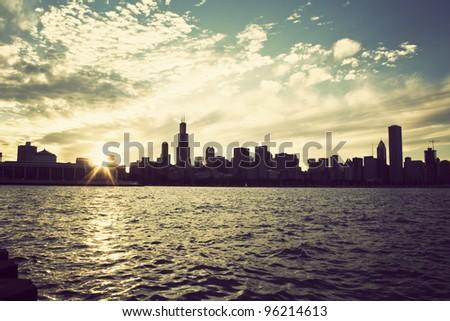Winter sun setting over the skyline of Chicago, Illinois - stock photo