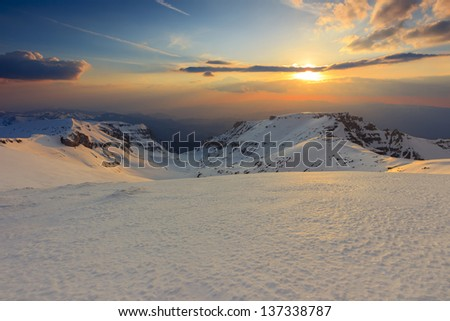 Winter sunset in the Bucegi mountains,Carpathians,Romania - stock photo