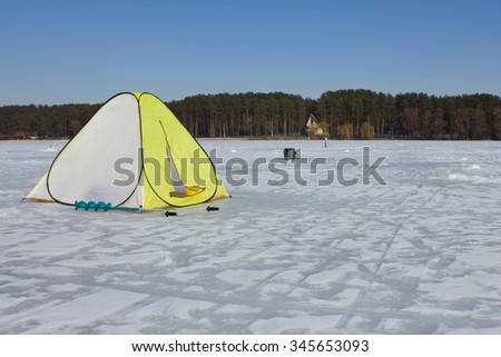 Winter tent on the ice - stock photo