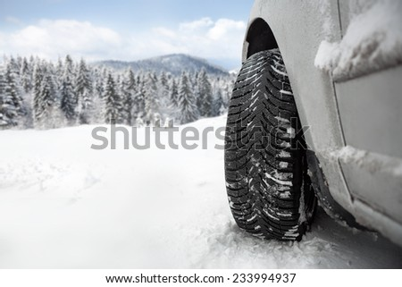 Winter tire in snow �¢?? close up - stock photo