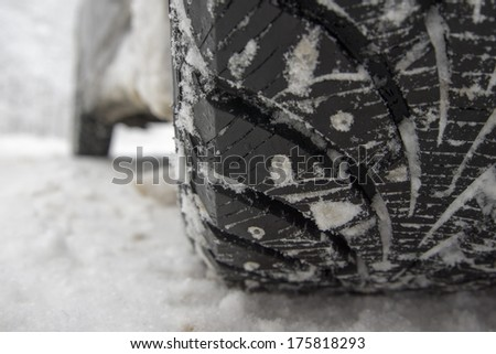 Winter tire on snow-covered road. - stock photo