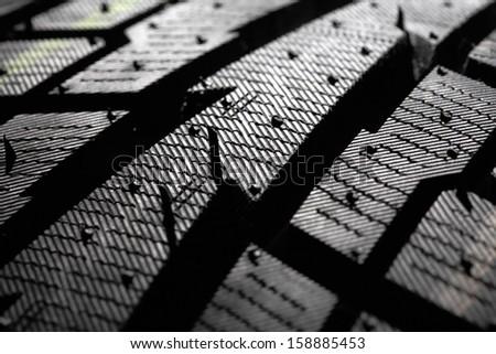 Winter tire pattern close-up, shallow DOF - stock photo