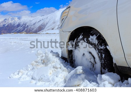 Winter tires are no help in this snow storm on mountain - stock photo