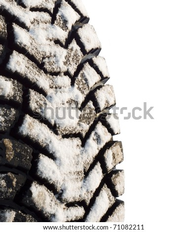 winter tires in snow, isolated on a white background - stock photo
