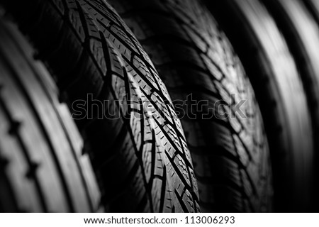 Winter Tires stack background. Selective focus. - stock photo