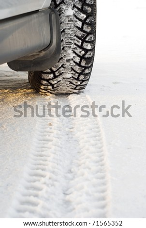 winter tires with spikes in snow - stock photo