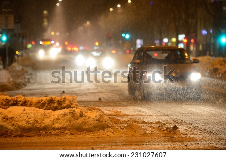 Winter traffic, in snowstorm - stock photo