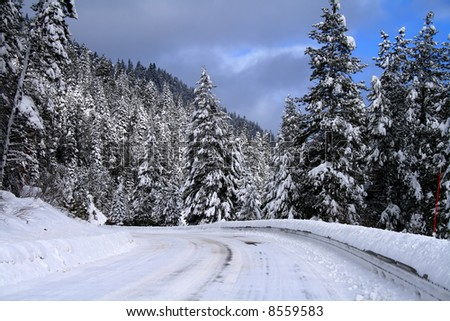 Winter travel on snowy roads in central Idaho - stock photo