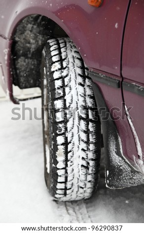 Winter tyre of lilac car - stock photo