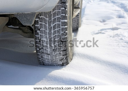 Winter tyres in extreme cold temperature - stock photo