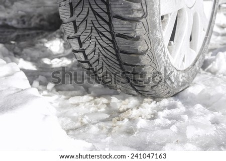 Winter tyres of a cars on a snowy road - stock photo