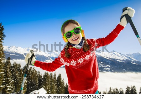 Winter vacation, snow, skier - girl enjoying winter - stock photo