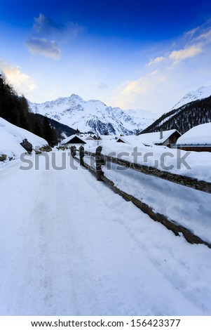 Winter vacations - winter scenery in the Alpine village - stock photo