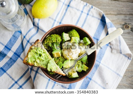 Winter vegetable salad with broccoli and cauliflower, toast with avocado, lunch,top view - stock photo