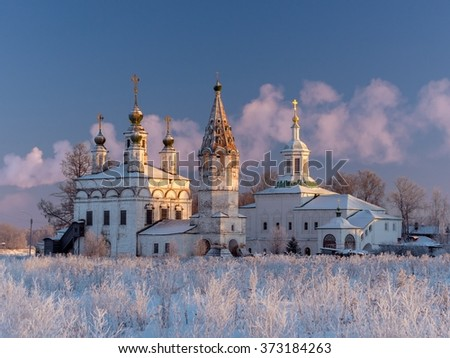 Winter view ensemble of ancient orthodox churches in Dymkovo Sloboda (built in 1747), Veliky Ustyug. Veliky Ustyug has great historical significance of Russian North. Shoot with a circular polarizer - stock photo